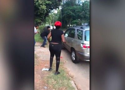Lexus SUV plows into young women fighting in street