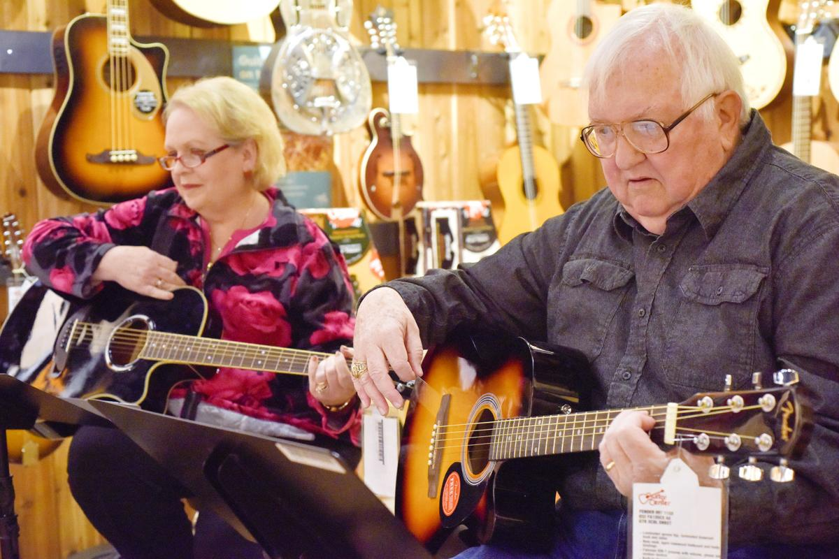 east texas senior citizens learn guitar at free community lessons local news. Black Bedroom Furniture Sets. Home Design Ideas