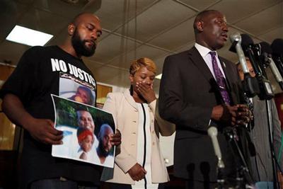 Witnesses: Teen had hands raised when he was shot