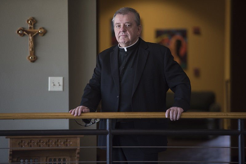 Father Tim Kelly, departing his Flint parish, reflects on his