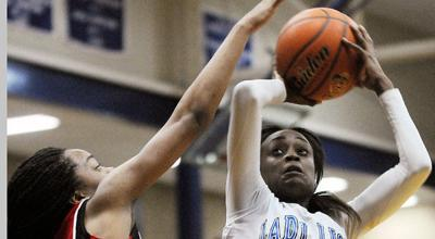 Lady Lions blow past Marshall, 76-42