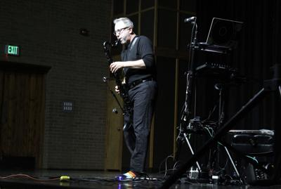 Electronic bass clarinetist visits music students