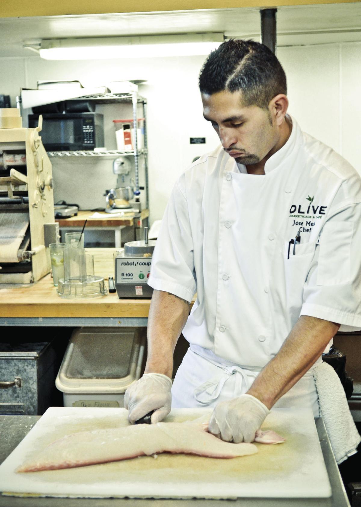 Meza prepares fish