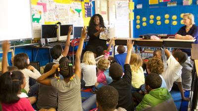 Classroom teachers school children elementary education teacher kids grade STANDING