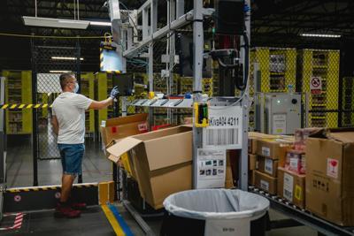 An employee at an Amazon fulfillment center