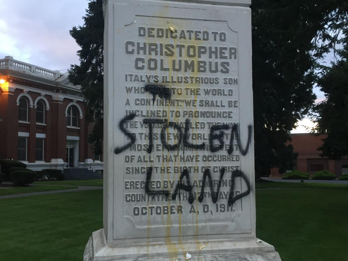 Columbus statue graffiti closeup