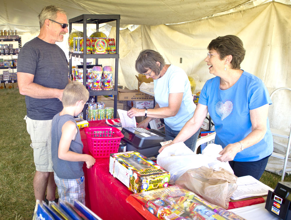 Joyce Paine And Remy Wilcox, Right, Help Jim Rush Buy Some Fireworks For  His Grandkids Daniel Rush, 7, And Bonnie Rush (not Pictured) Monday At The  Good ...