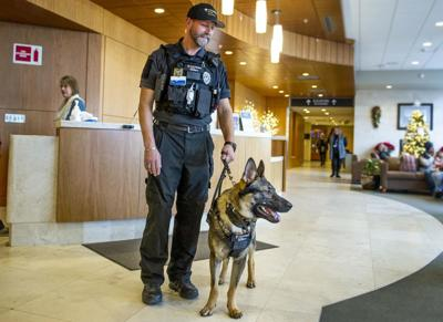 Providence St. Mary Security Officer Mike Smith patrols the hospital with Axel