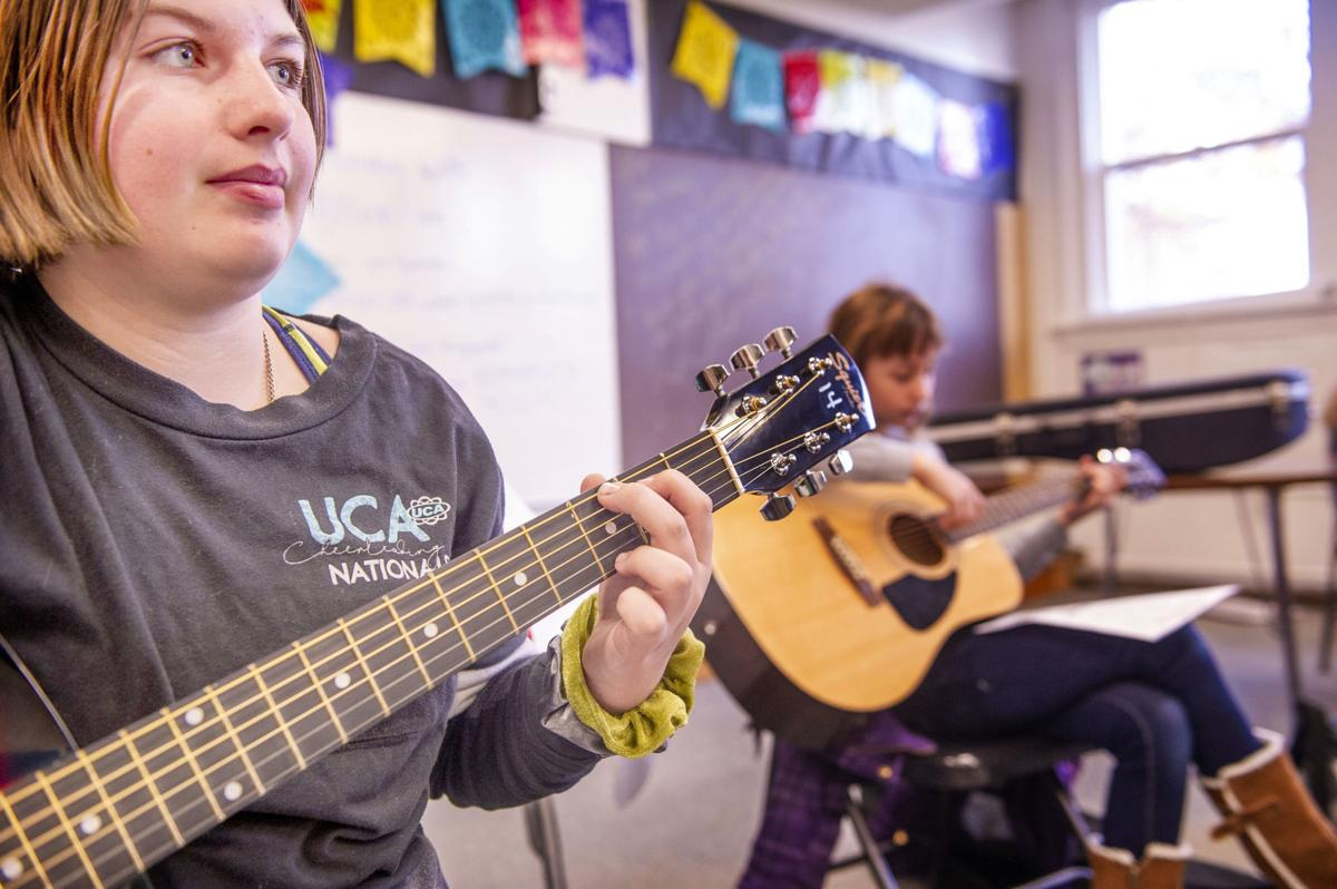 Students learn guitar