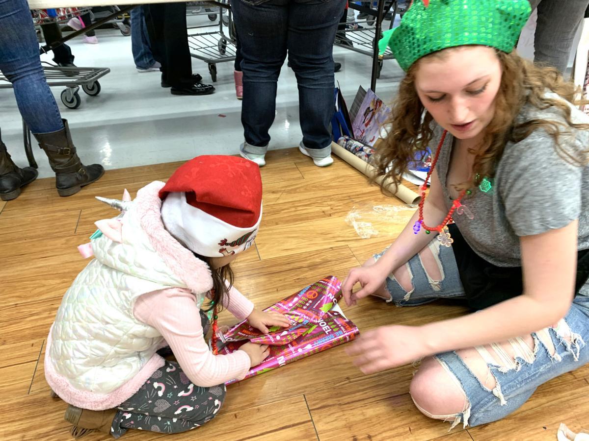 Jessica and child wrapper.jpg