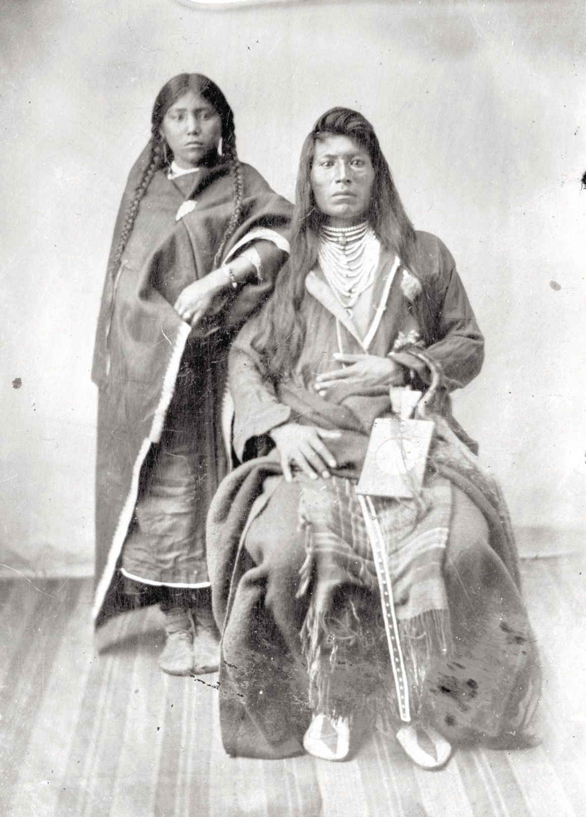 Plateau Indian man and woman, 1860s
