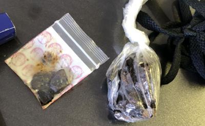 'Suspicious-looking vehicle' leads to arrests, seizure of vehicle, drugs, gun