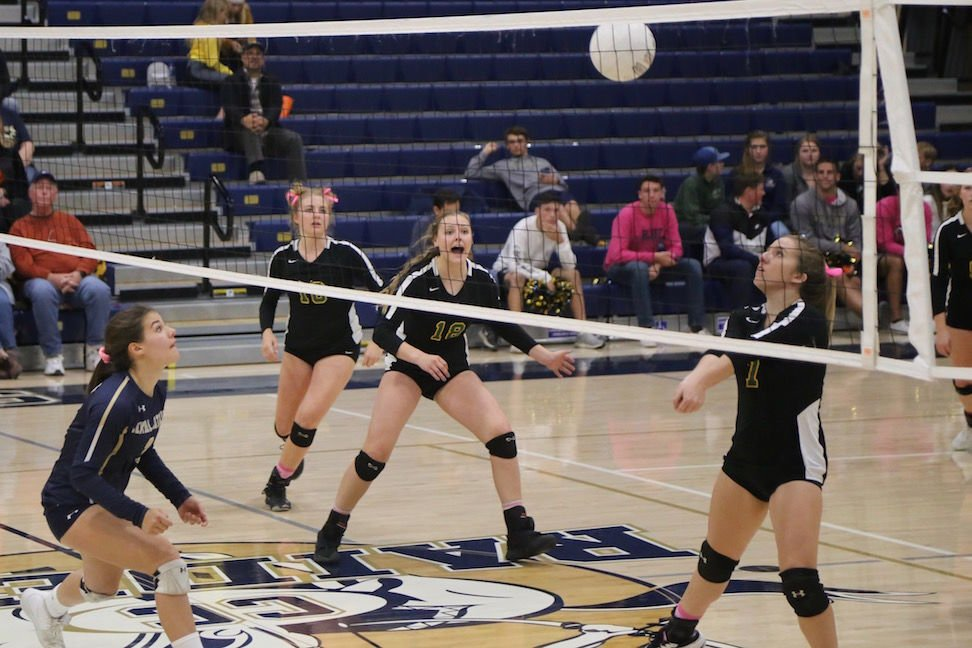 Sonora Wildcats varsity volleyball players Jacey Hawkins, number 16, Hope Houck, number 18, and Mandy Teem, number 7, build an attack Thursday night on Central Catholic  in a second-round match of the 2019 CIF Sac-Joaquin Section Volleyball Division III playoffs in Modesto.