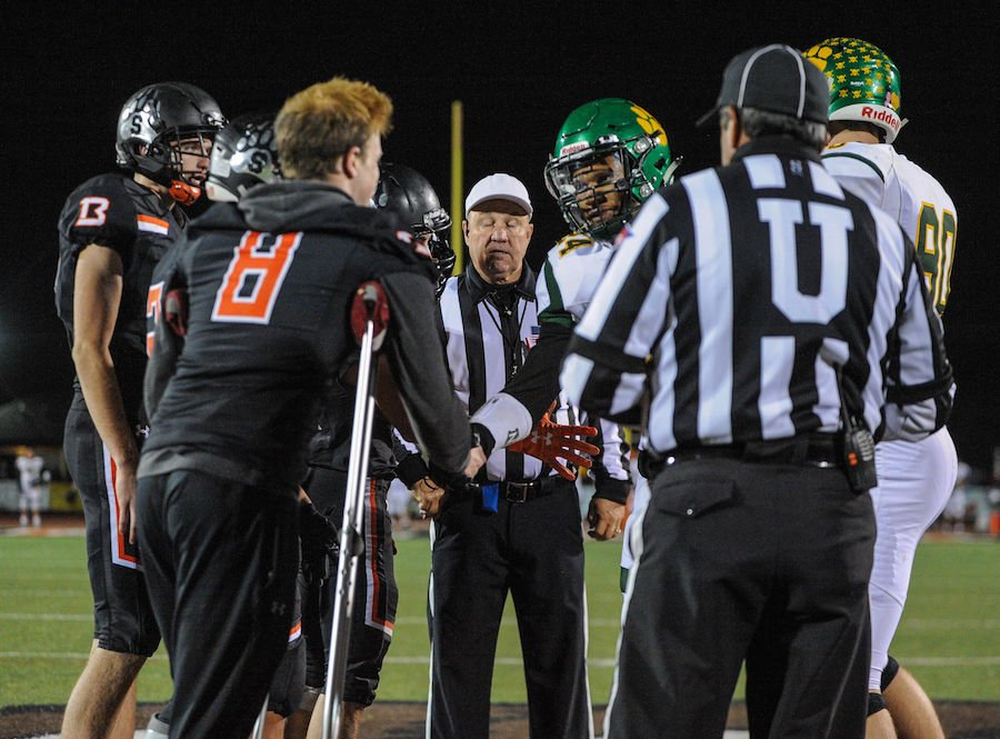 Captains for both teams meet for the coin toss during the high school game between the Sonora High School Wildcats and Summerville High School Bears at Summervilles Thorsted Field on November 1, 2019 in Tuolumne, CA.