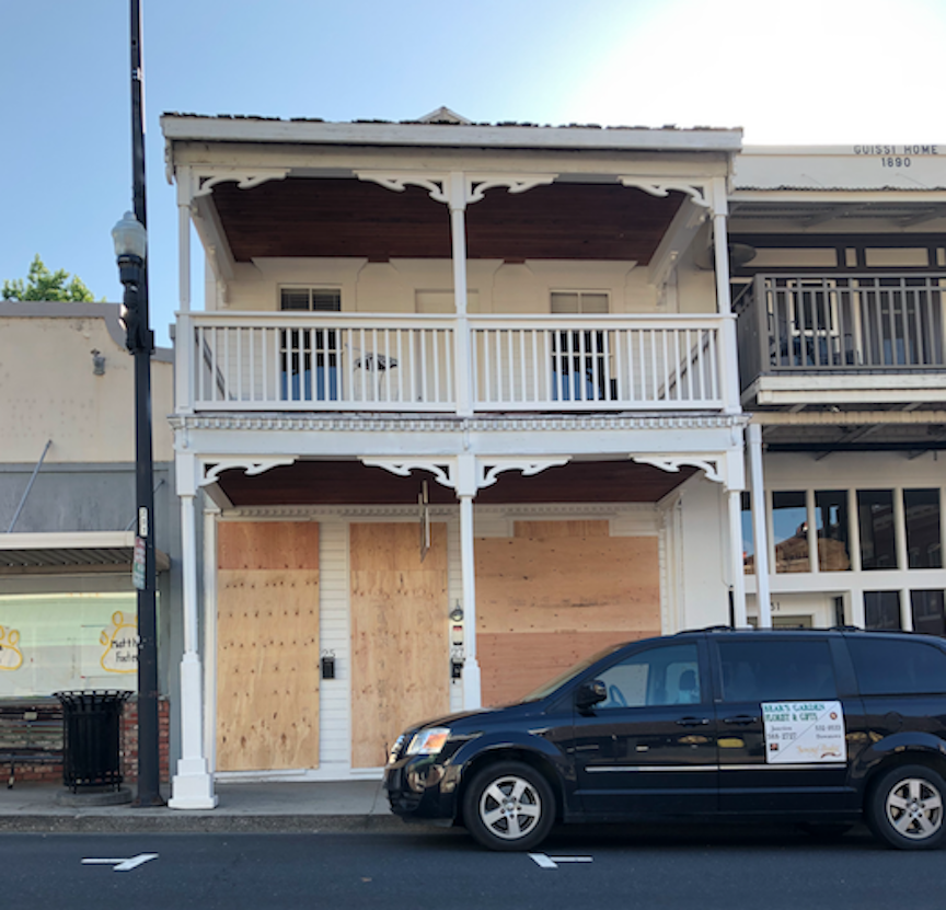 Boarded up building