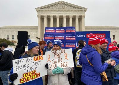 Hundreds of supporters of gun control laws rally in front of the U.S. Supreme Court