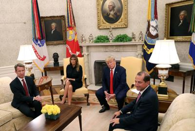 President Trump speaks to members of the news media in the Oval Office