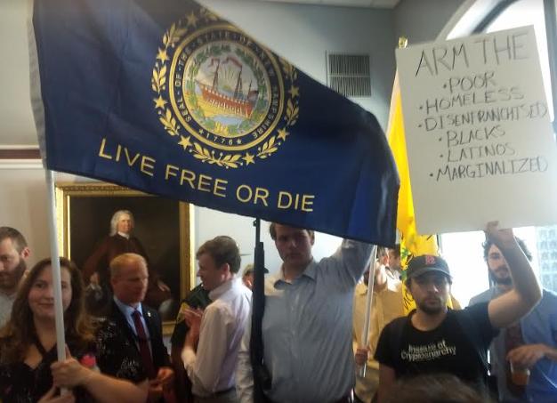 Gun right advocates show off shotgun in protest