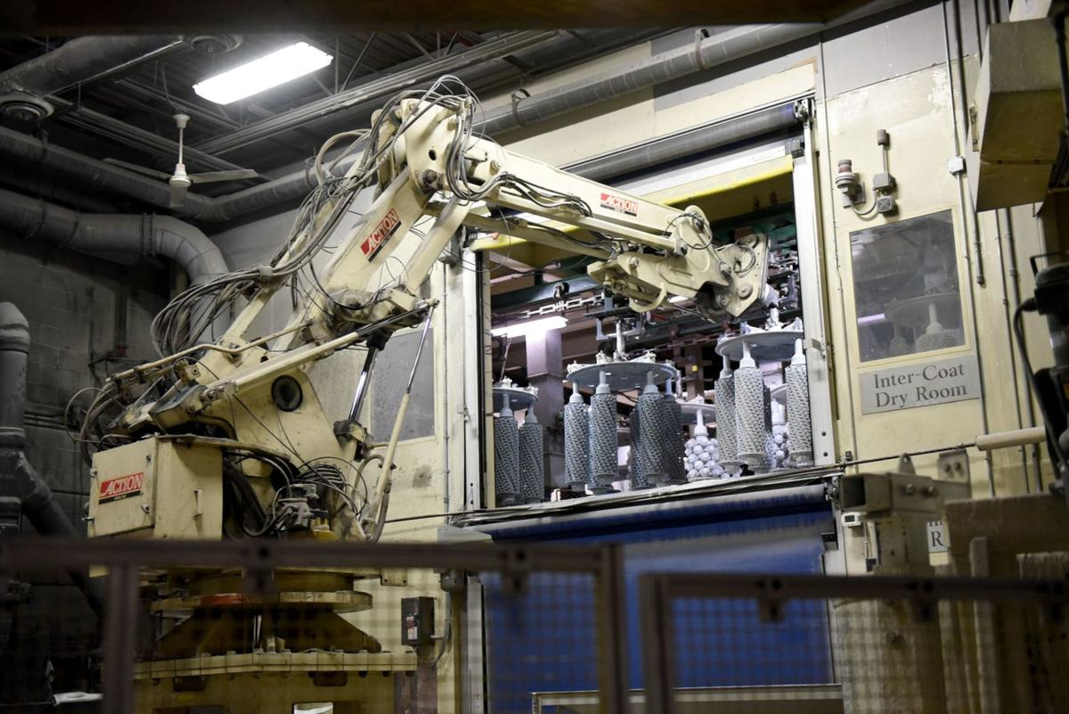 Robot places coated parts in a dryer