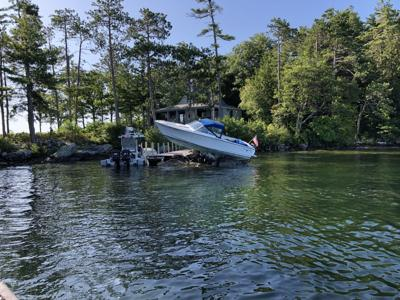 Boat driven aground on Winnipesaukee after collision with