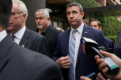 U.S. Representative Duncan Hunter leaves federal court after pleading guilty to misusing campaign funds in San Diego