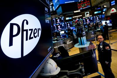 FILE PHOTO: FILE PHOTO: A logo for Pfizer is displayed on a monitor on the floor at the NYSE in New York