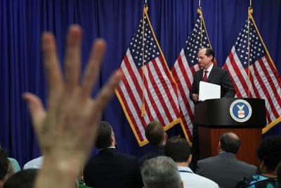 U.S. Labor Secretary Alexander Acosta departs news conference
