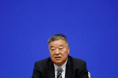 Liang Wannian, the Chinese team leader on the World Health Organization (WHO) joint expert team, attends a news conference in Beijing