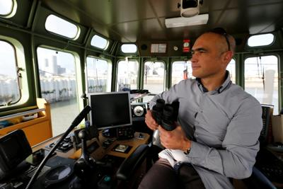 Tugboat captain Jean-Yves Lagarde works on the VB Cognac tugboat at the commercial harbour of La Rochelle