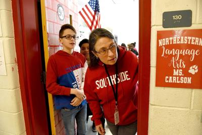 Michele Wood looks out the classroom door