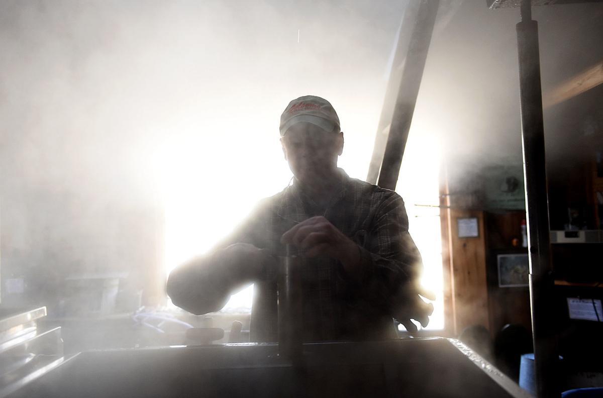 Brian Folsom checks the temperature of his boiling evaporator