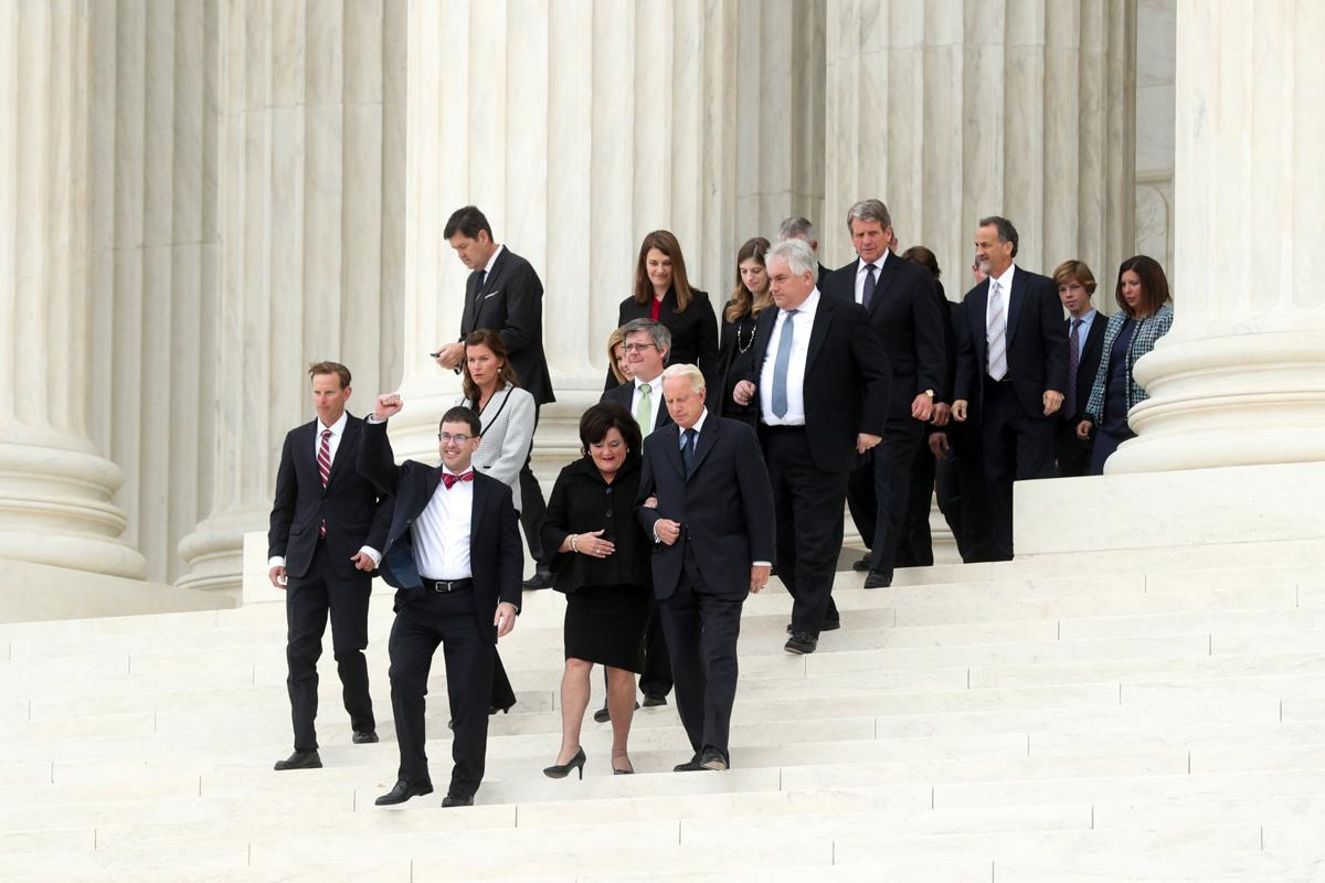 Attorney John Bursch, with Rost, pumps his arm as he exits the U.S. Supreme Court in Washington