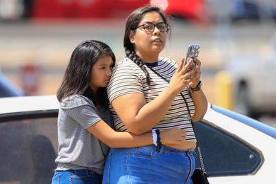 A girl reacts after a mass shooting at a Walmart in El Paso