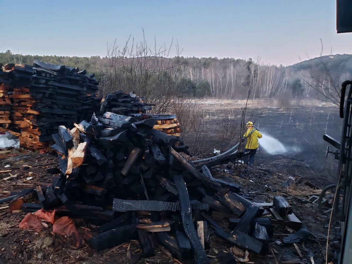 Gilford firefighters battle brush fire at Beans and Greens Farm