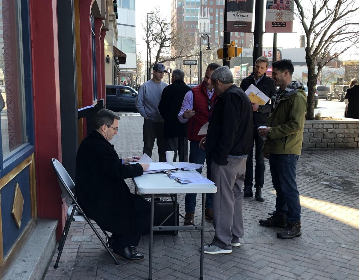 Purchase and sale agreement signed on Elm Street sidewalk