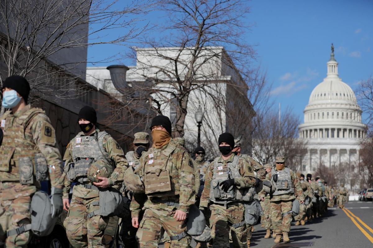 Members of the National Guard patrol near the U.S. Capitol building ahead of U.S. President-elect Joe Biden's inauguration
