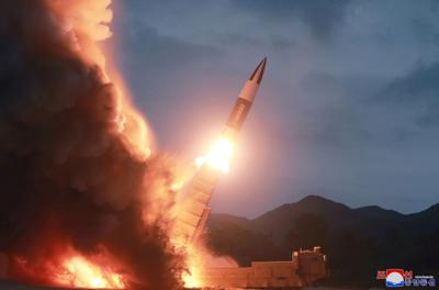 KCNA picture of North Korea test firing a new weapon