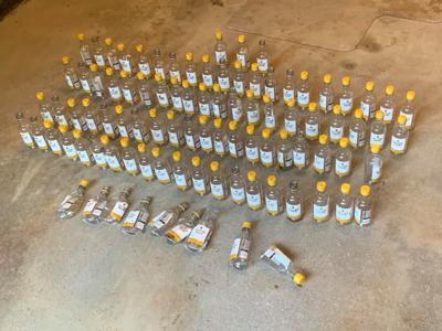 Mini wine bottles littering roadway in Lee