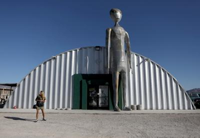 People visit the Alien Research Center in Hiko, as an influx of tourists responding to a call to 'storm' Area 51, is expected in Rachel, Nevada