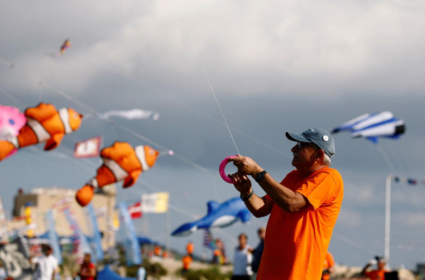 An enthusiast flies a kite during the International Kite and Wind festival outside the village of Gharb, on the island of Gozo | Human Interest | unionleader.com