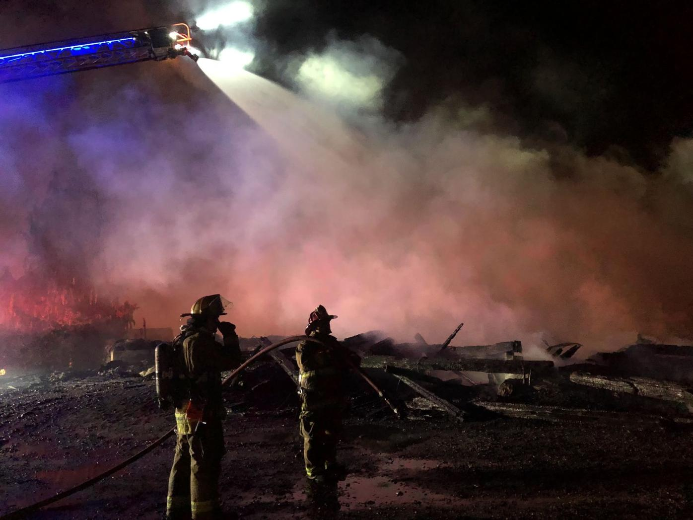 Firefighters work to control Stratham fire