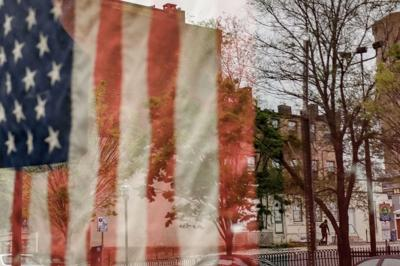 An American flag hangs in Baltimore