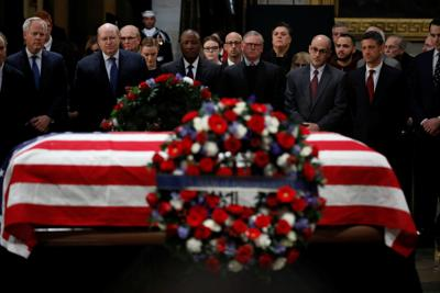 Former personal aides pay their respects at the casket of former U.S. President George H.W. Bush