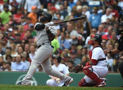Yankees beat Sox, set HR record