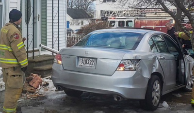 Manchester police probe car striking local home, driver hurt