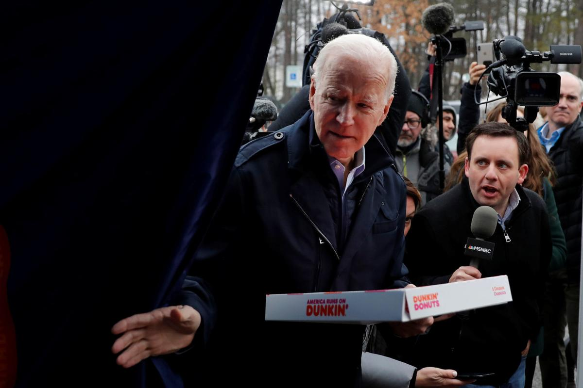 Democratic 2020 U.S. presidential candidate and former Vice President Joe Biden visits a polling station on the day of New Hampshire's first-in-the-nation primary in Manchester, New Hampshire U.S.