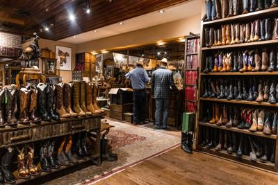 Customers shop for boots in Fort Worth