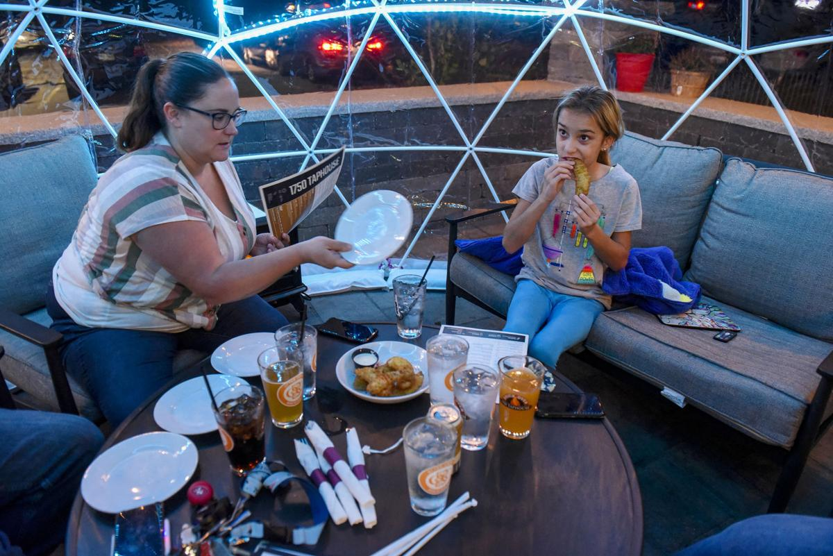 Family enjoys 'igloo' at 1750 Taphouse