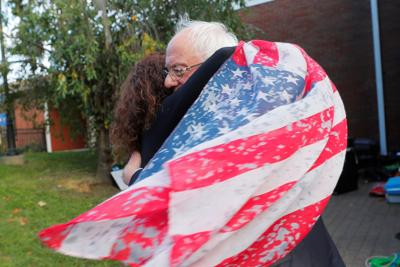 Democratic candidate Bernie Sanders gets a hug from Dover supporter