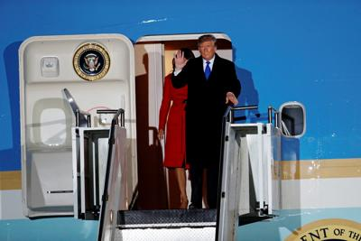 U.S. President Donald Trump and first lady Melania arrive at Stansted Airport